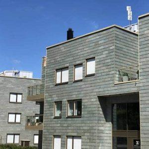 Bostadshus med takskifferfasad i Stocksund Nordskiffer Grön i enkeltäckning