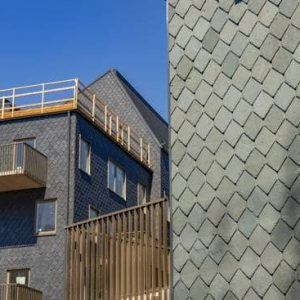 Fasad med skiffer klippt i spets Uggleberget