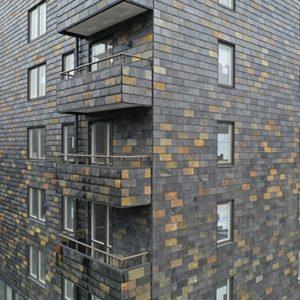 Otta Rost takskiffer på fasad i Stockholm