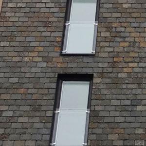 Projekt Lamellhusen - Hus klätt med takskiffer på fasad