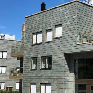 Projekt Patriam med skifferfasad i enkeltäckning på flerfamiljshus