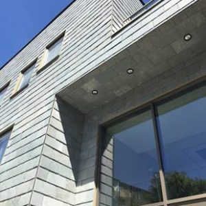 Takskiffer på fasad monterad med fasadsytem Nordclad