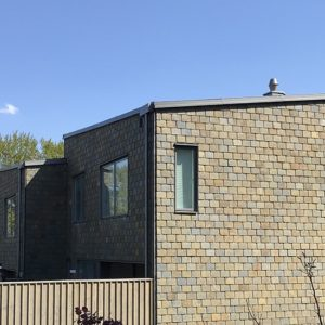 Hus klädda med Multicolor takskiffer på fasad, projekt Strandängen i Jönköping