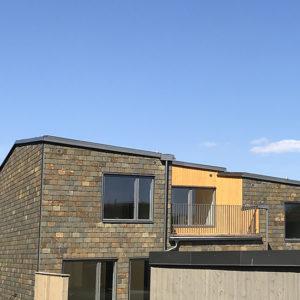 Hus klädda med Multicolor takskiffer på fasad