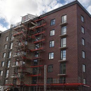 Projekt med Nordskiffer Röd monterad i enkeltäckning - Haninge, Stockholm