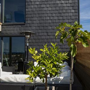 Nordskiffer Classic takskiffer på fasad i dubbeltäckning - Ålabodarna