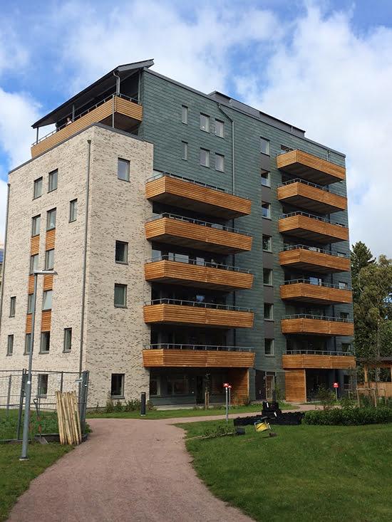 Takskiffer på fasad - projekt i Skövde klädd med Nordskiffer Grön