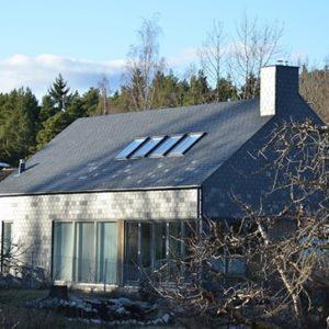 Takskiffer på tak och fasad i olika kulörer