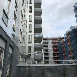 Skuren skiffer limmad på sockel, flerfamiljshus i Linköping, Projekt Brandstationen