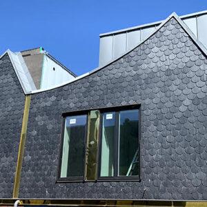 Hus klädda med Nordskiffer Classic på Projekt Morgondoppet i Lanskrona