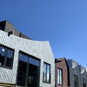 Projekt Morgondoppet hus klädda med skiffer, Nordskiffer Grön och Classic