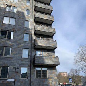 Otta Rost på fasaderna, brandtestat fasadsystem med takskifferplattor, Fyrtornet